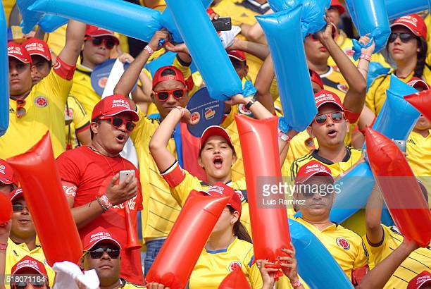 Fans of Colombia cheer for their team during a match between Colombia and Ecuador as part of FIFA 2018 World Cup Qualifiers at Roberto Melendez...