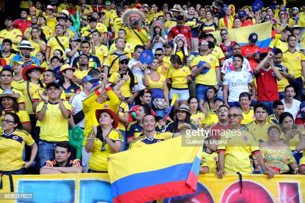 Fans of Colombia cheer for their team prior a match between Colombia and Paraguay as part of FIFA 2018 World Cup Qualifiers at Metropolitano Roberto...