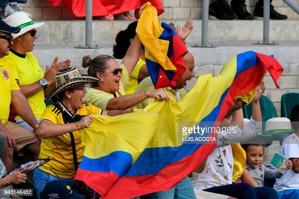 Fans of Colombia cheer their team during the Americas Zone Group I 2nd round Davis Cup tennis doubles match between Colombian tennis players Juan...
