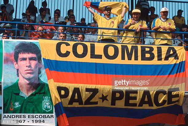 Fans of Colombia display a banner from Andres Escobar who was murdered after the World Cup 1994 during the FIFA World Cup group d match between...
