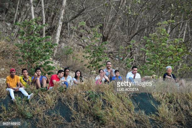 Fans of Colombia watch the Americas Zone Group I 2nd round Davis Cup tennis doubles match between Colombian tennis players Juan Sebastian Cabal and...