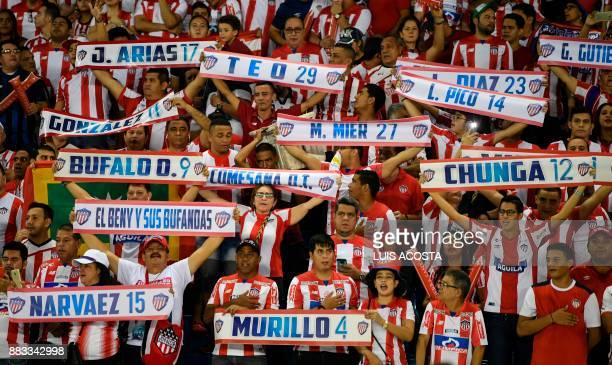 Fans of Colombian team Junior cheer for their team during the Copa Sudamericana semifinal second leg football match against Brazilian Flamengo at the...