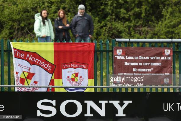 Fans of Connah's Quay Nomads watch the game from the outside perimeter of the stadium during the Cymru Welsh Premier League match between Penybont...