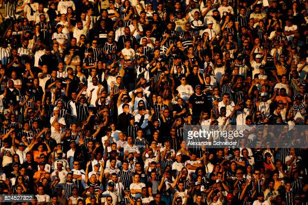 Fans of Corinthians cheer during the match between Corinthians and Flamengo for the Brasileirao Series A 2017 at Arena Corinthians Stadium on July 30...