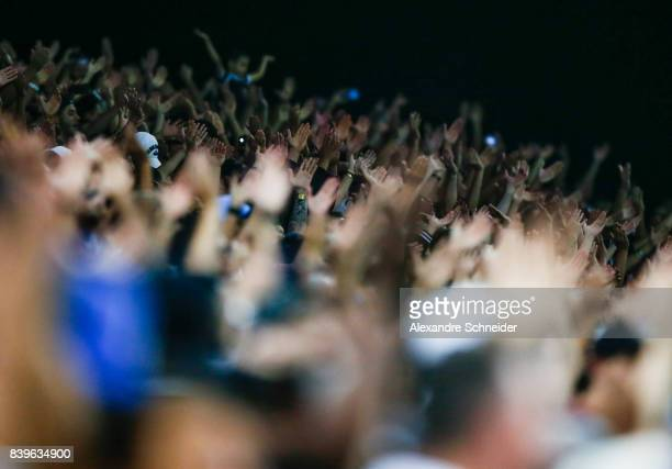 Fans of Corinthians cheer during the match between Corinthians and Atletico GO for the Brasileirao Series A 2017 at Arena Corinthians Stadium on...