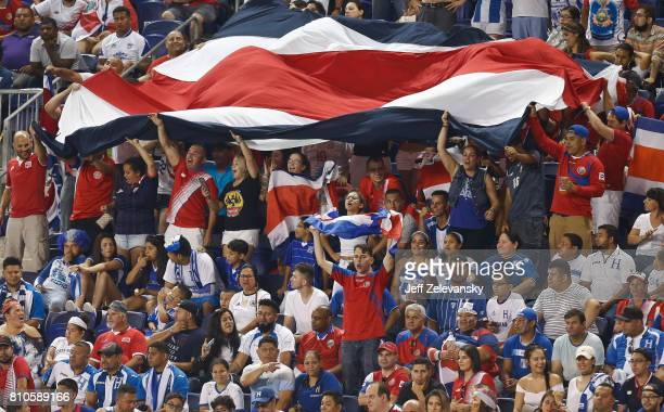 Fans of Costa Rica cheer during their CONCACAF Gold Cup match against Honduras at Red Bull Arena on July 7 2017 in Harrison New Jersey