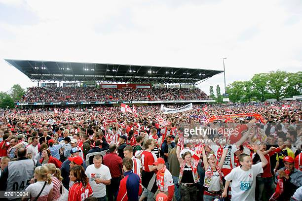 Fans of Cottbus celebrate after the winning Second Bundesliga match between Energie Cottbus and 1860 Munich at the Stadion der Freundschaft on May 14...