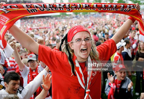 Fans of Cottbus celebrates after the winning Second Bundesliga match between Energie Cottbus and 1860 Munich at the Stadion der Freundschaft on May...