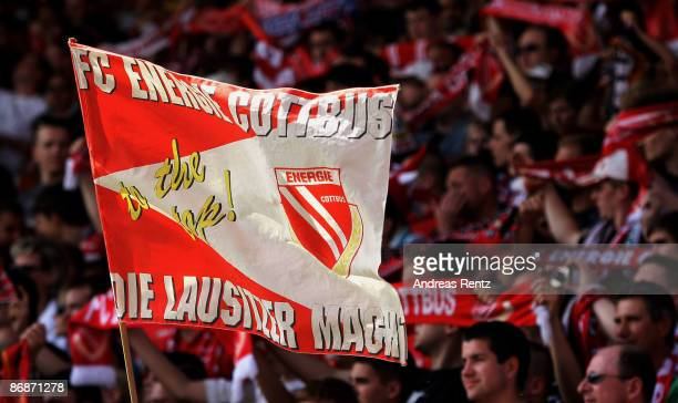 Fans of Cottbus wave a flag during the Bundesliga match between FC Energie Cottbus and Bayern Muenchen at the Stadion der Freundschaft on May 9, 2009...