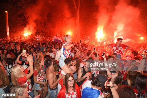 Fans of Croatia celebrate after Croatia advances to their first ever World Cup final after beating England 21 in the 2018 FIFA World Cup Russia Semi...