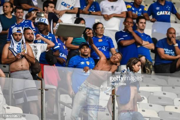 Fans of Cruzeiro react after losing a match against Palmeiras as part of Brasileirao Series A 2019 at Mineirao Stadium on December 8, 2019 in Belo...