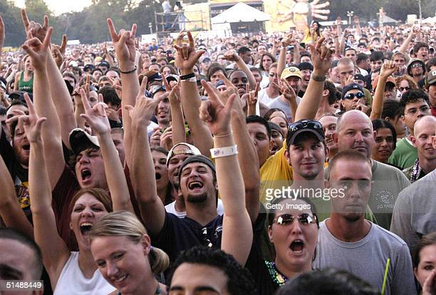 Fans of Cypress Hill cheer during the bands performance at the Voodoo Music Experience 2004 Day One on October 16 2004 in New Orleans Louisiana