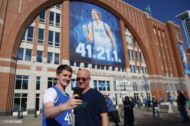 Fans of Dallas Mavericks take a salfie prior the game between Phoenix Suns and Dallas Mavericks at American Airlines Center on April 9 2019 in Dallas...