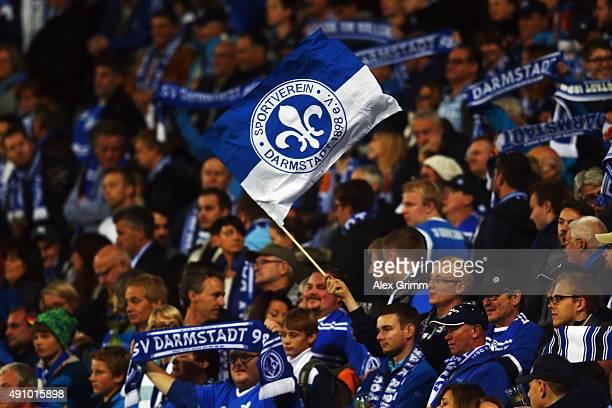 Fans of Darmstadt wave their flags prior to the Bundesliga match between SV Darmstadt 98 and 1.FSV Mainz 05 at Merck-Stadion am Boellenfalltor on...