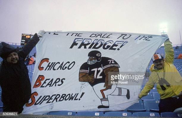 Fans of defensive lineman William Perry of the Chicago Bears display a banner which reads Give the Ball to the Fridge during a game between the Bears...