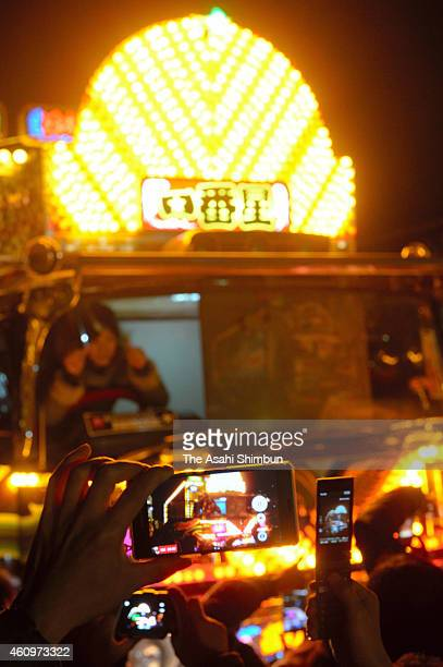 Fans of 'Dekotora' decoration trucks take photographs of the dekotora 'Ichibanboshi' during the a commemorative event for late actor Bunta Sugawara...