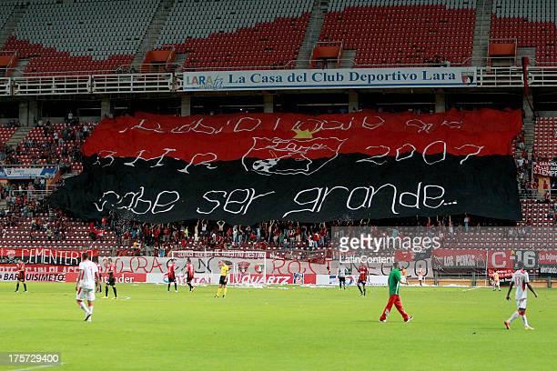 Fans of Deportivo Lara display a flag Deportivo Lara during a match between Deportivo Lara and Liga de la Loja as part of the Copa Total Sudamericana...