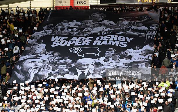 Fans of Derby County unvail a large banner in the stand during the Sky Bet Championship match between Derby County and Nottingham Forest at the iPro...