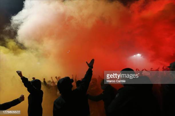 Fans of Diego Armando Maradona, with smoke bombs in front of the San Paolo stadium in Naples, the day after the death of the famous and legendary...