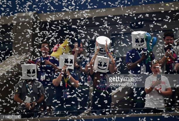 Fans of Dj Marshmello watch his performance ahead of the final of the Solo competition at the 2019 Fortnite World Cup July 28 2019 inside of Arthur...