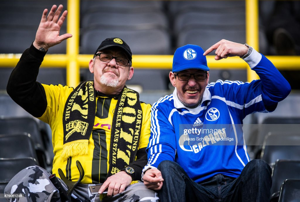Fans of Dortmund and Schalke look up prior to the Bundesliga match between Borussia Dortmund and FC Schalke 04 at Signal Iduna Park on November 25, 2017 in Dortmund, Germany.