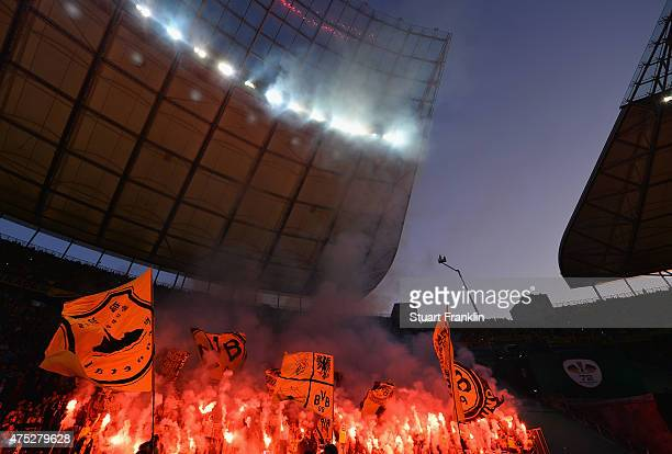 Fans of Dortmund are seen with flares during the DFB Cup Final match between Borussia Dortmund and VfL Wolfsburg at Olympiastadion on May 30 2015 in...
