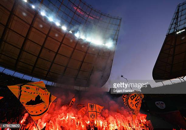 Fans of Dortmund burn flares during the DFB Cup Final between Borussia Dortmund and VfL Wolfsburg at Olympiastadion on May 30 2015 in Berlin Germany