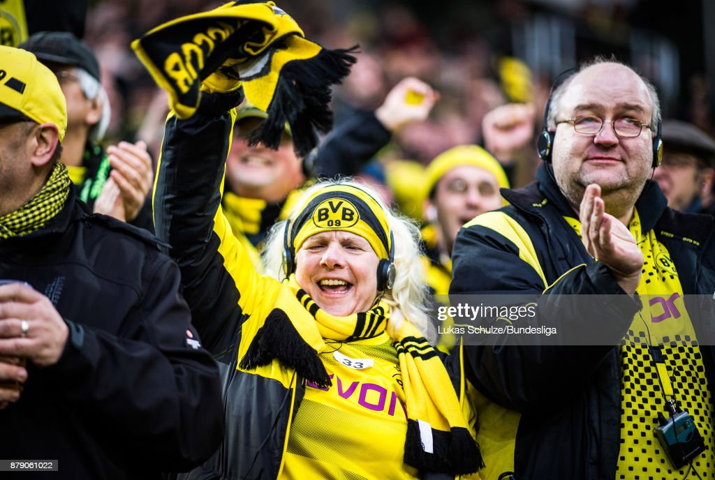Fans of Dortmund celebrate a goal of their team during the Bundesliga match between Borussia Dortmund and FC Schalke 04 at Signal Iduna Park on November 25, 2017 in Dortmund, Germany.