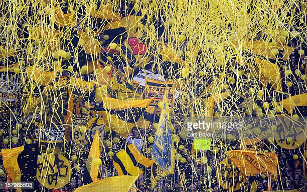Fans of Dortmund celebrate after 12:12 minutes during the Bundesliga match between Borussia Dortmund and VfL Wolfsburg at Signal Iduna Park on...