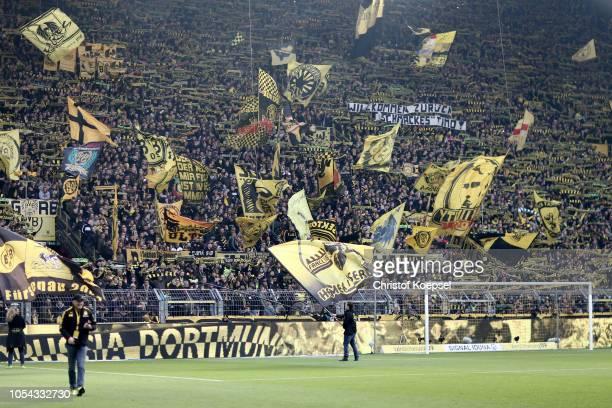 Fans of Dortmund celebrate during the Bundesliga match between Borussia Dortmund and Hertha BSC at Signal Iduna Park on October 27 2018 in Dortmund...
