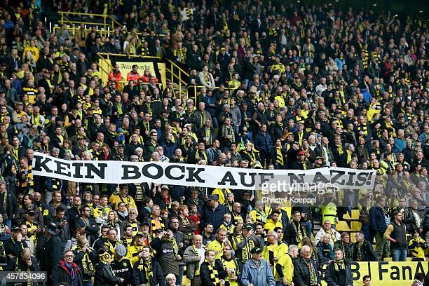 Fans of Dortmund show a banner against racism during the Bundesliga match between Borussia Dortmund and Hannover 96 at Signal Iduna Park on October...
