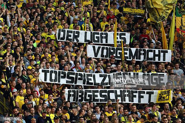 Fans of Dortmund show banner prior to the Bundesliga match between Borussia Dortmund and FC Bayern Muenchen at Signal Iduna Park on May 4 2013 in...