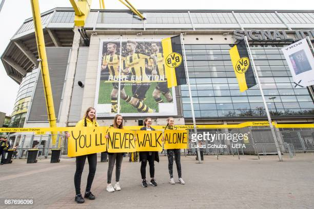 Fans of Dortmund show some signs depicting You'll never walk alone prior to the UEFA Champions League Quarter Final first leg match between Borussia...