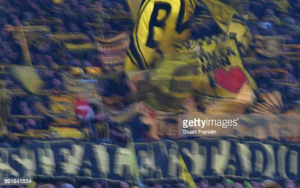 Fans of Dortmund show their support during the Bundesliga match between Borussia Dortmund and SV Werder Bremen at Signal Iduna Park on December 9...