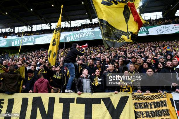 Fans of Dortmund stand on the north tribune instead of the empty close sout tribune prior to the Bundesliga match between Borussia Dortmund and VfL...