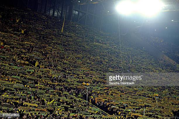 Fans of Dortmund stand together and mourn a person who died during the Bundesliga match between Borussia Dortmund and 1 FSV Mainz 05 at Signal Iduna...