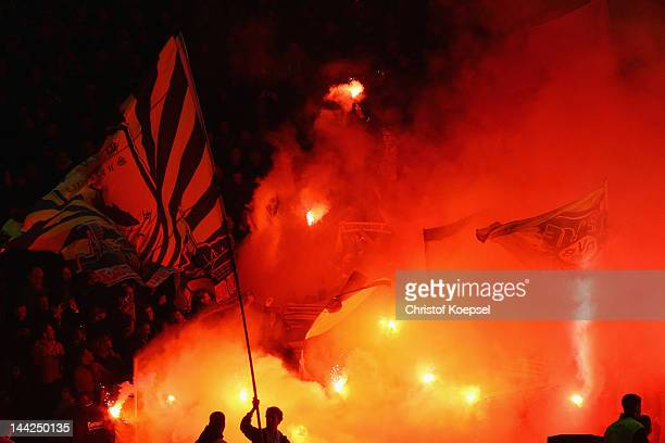 Fans of Dortmund throw smokebombs during the DFB Cup final match between Borussia Dortmund and FC Bayern Muenchen at Olympic Stadium on May 12 2012...