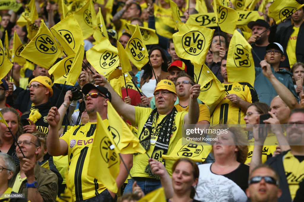 Fans of Dortmund wave their flags during the Borussia Dortmund Season Opening 2017/18 at Signal Iduna Park on August 4, 2017 in Dortmund, Germany.