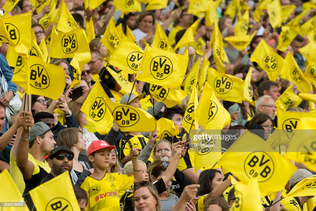 Fans of Dortmund wave their flags during the Borussia ...