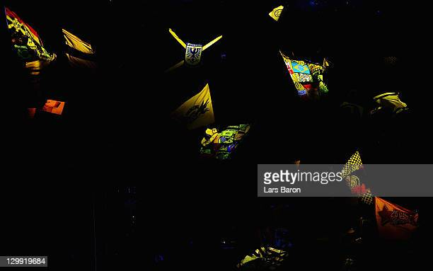 Fans of Dortmund wave their flags prior to the Bundesliga match between Borussia Dortmund and 1 FC Koeln at Signal Iduna Park on October 22 2011 in...