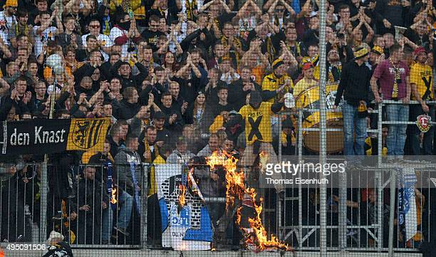 Fans of Dresden burns supporter stuff of Magdeburg after the Third League match between SG Dynamo Dresden and 1 FC Magdeburg at Stadion Dresden on...