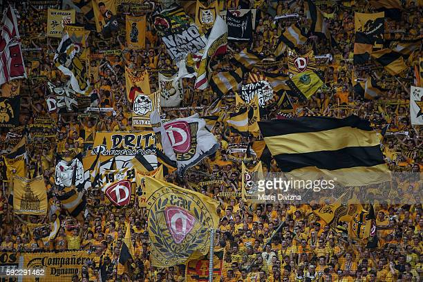 Fans of Dresden cheer before the DFB Cup match between Dynamo Dresden and RB Leipzig at DDVStadion on August 20 2016 in Dresden Germany