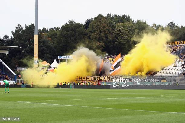 Fans of Dresden fire smoke-bombs during the Second Bundesliga match between SV Darmstadt 98 and SG Dynamo Dresden at Merck-Stadion am Boellenfalltor...