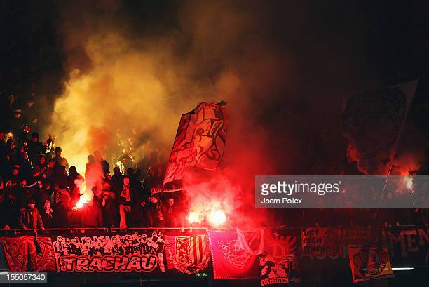 Fans of Dresden light flares prior to the second round DFB Cup match between Hannover 96 and Dynamo Dresden at AWD Arena on October 31 2012 in...