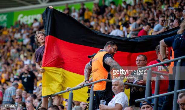 Fans of Dresden show the german flag during the Second Bundesliga match between SG Dynamo Dresden and FC St Pauli at RudolfHarbigStadion on August 31...