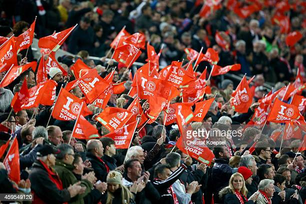Fans of Duesseldorf wave flags prior to the Second Bundesliga match between Fortuna Duesseldorf and Greuther Fuerth at EspritArena on November 24...