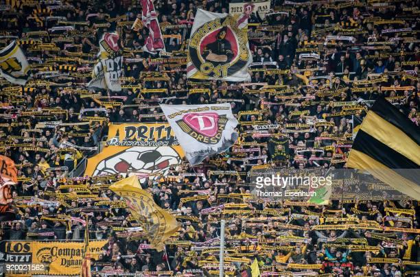 Fans of Dynamo Dresden support the team during the Second Bundesliga match between SG Dynamo Dresden and SSV Jahn Regensburg at DDVStadion on...