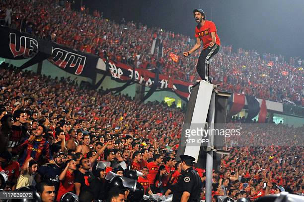 Fans of Egypt's AlAhly cheer for their team during their Egyptian League football match against rival club Zamalek in Cairo on June 29 2011 AFP PHOTO...