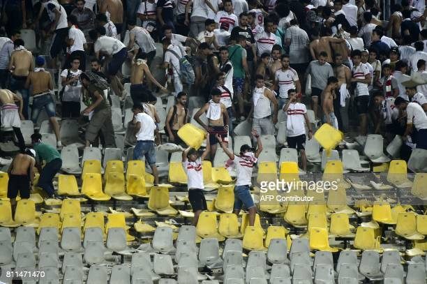 Fans of Egypt's Zamalek destroy chairs at Borg elArab Stadium following the football match of their club against Al Ahly Tripoli during their African...