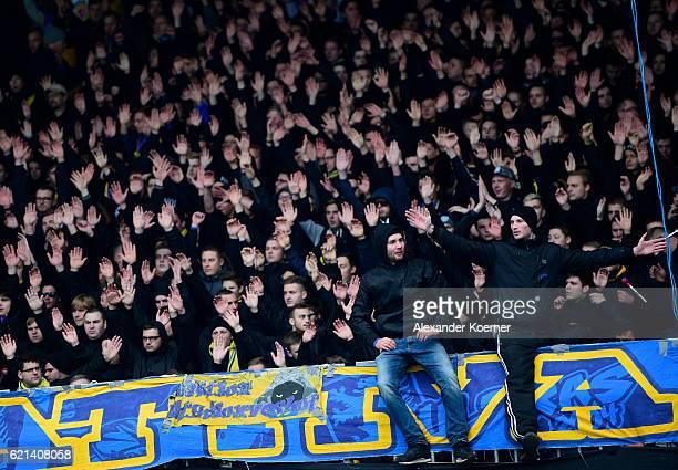 Fans of Eintracht Braunschweig sing prior the second Bundesliga match between Eintracht Braunschweig and Hannover 96 at Eintracht Stadion on November...